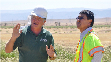 Photo of a USGS California Water Science Center Hydrologist with a partner agency representative